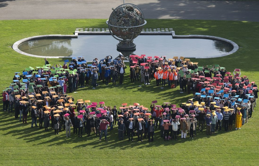 UN Photo/Jean-Marc Ferré Aerial group photo of staff in Geneva simulating the Sustainable Development Goals logo on United Nations Staff Day in October 2016.