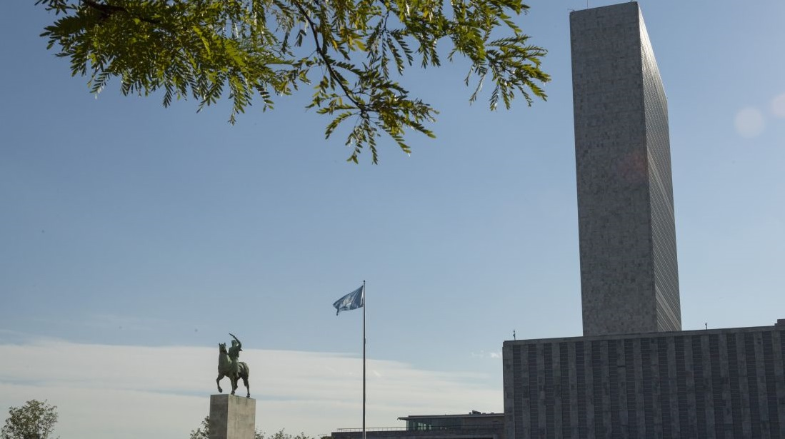 A view of the General Assembly and Secretariat buildings at UN Headquarters, as well as the equestrian statue symbolizing Peace.