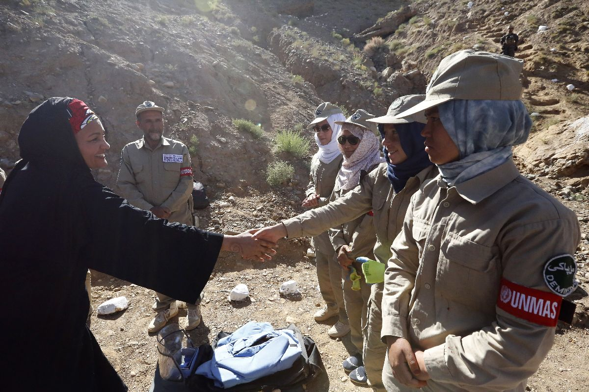 Deputy Secretary-General Amina Mohammed greets women deminers at a UN demining site in Afghanistan